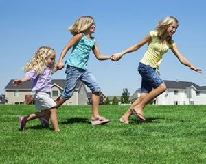 kids holding hands outside