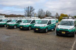 row of pest control tech vehicles